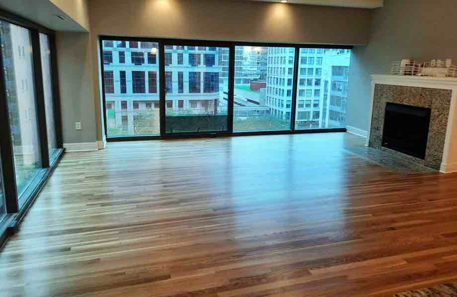 Beautiful multi tone hardwood sand and finish flooring project completed in downtown KC high-rise apartment