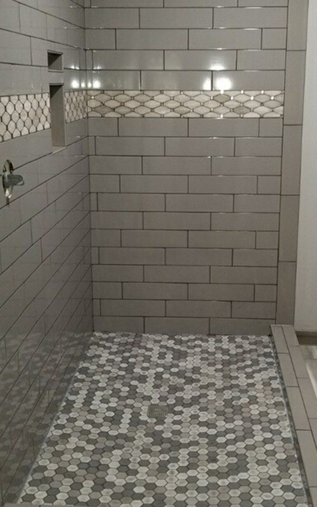 Custom shower design and installation featuring 4 x 16 Taupe Glossy Subway tiles, Octagon tiles, and decorative mixed blend mosaics in grey tones