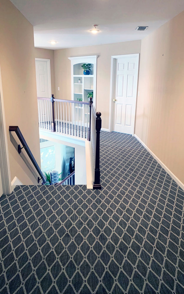 Anderson Tuftex Marrakech Stately Gray patterned Stainmaster carpet installed in hallway.