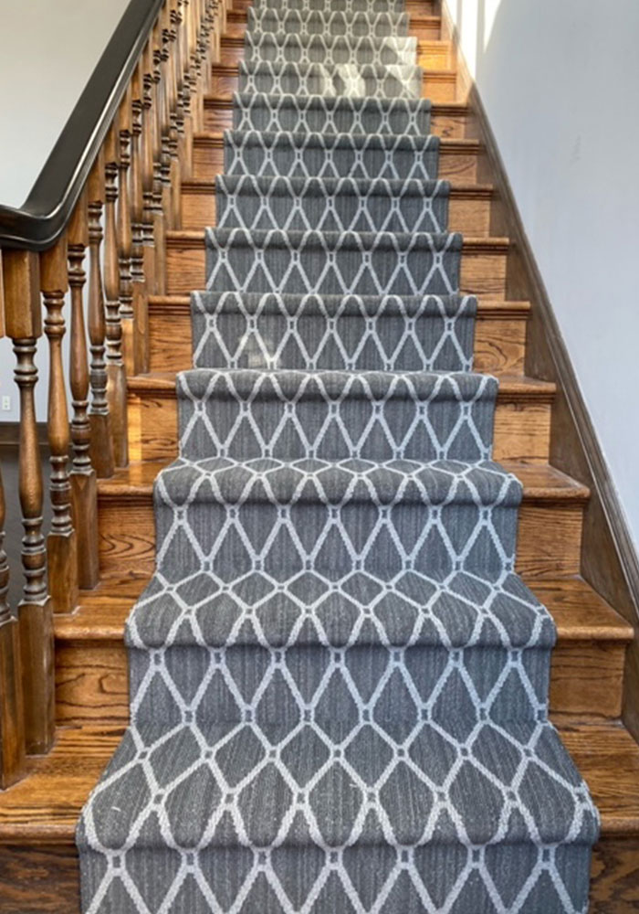 Stair runner installation with Anderson Tuftex Marrakech Stately Gray patterned Stainmaster carpet.