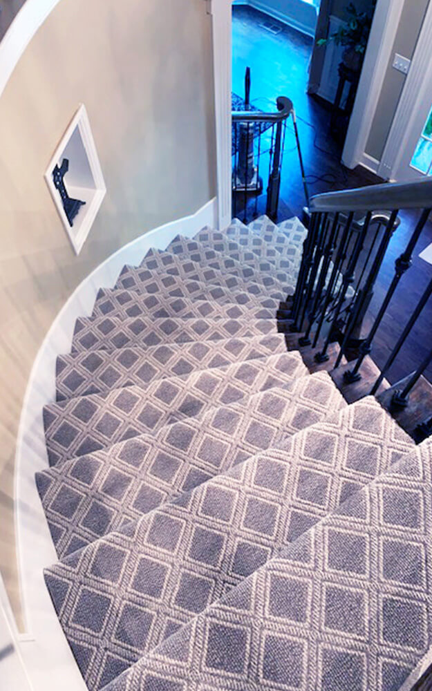Anderson Tuftex Scout carpet in color Oxford was installed for our client. The pattern created a timeless, tailored appeal for this architectural focal point.