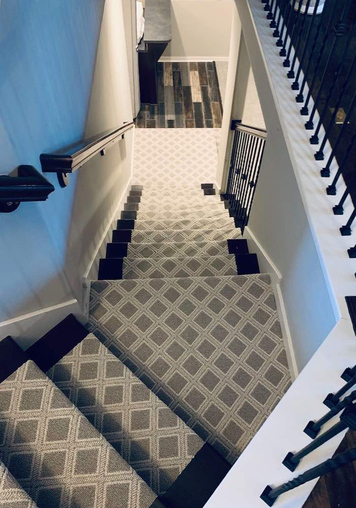 Anderson Tuftex Scout Oxford patterned carpet installed on stairs by Big Bob's Outlets of Kansas City.